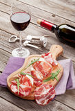 Prosciutto and mozzarella with red wine Stock Photography