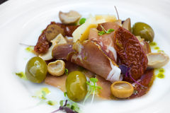Prosciutto with olive sheese and Cherry tomato Stock Image