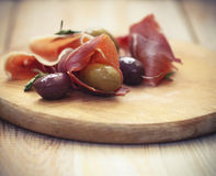 Prosciutto with olives and rosemary Royalty Free Stock Photos