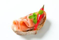 Prosciutto open faced sandwich Stock Photo
