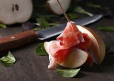 Prosciutto with pear and spinach . Royalty Free Stock Image
