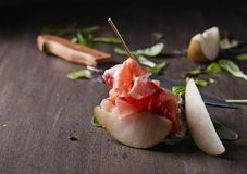 Prosciutto with pear and spinach . Royalty Free Stock Photography