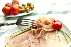 Prosciutto plate. With olives, tomatos royalty free stock photo