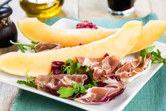 Prosciutto with rocket and cantaloupe salad Royalty Free Stock Images