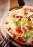 Prosciutto and rocket pizza Stock Photos