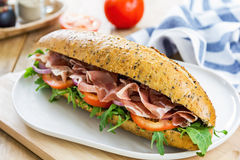 Prosciutto with rocket on sesame baguette Royalty Free Stock Photos
