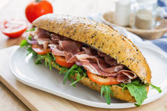 Prosciutto with rocket on sesame baguette Royalty Free Stock Photography