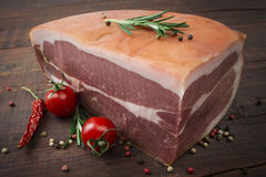Prosciutto with rosemary, pepper and spices. Stock Photography