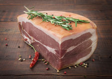 Prosciutto with rosemary, pepper and spices. Royalty Free Stock Photo
