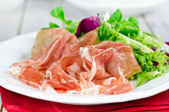 Prosciutto with salad Stock Photography