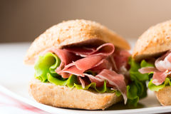Prosciutto sandwich on plate Stock Photography