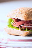 Prosciutto sandwich on plate macro vertical Stock Images