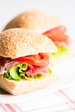 Prosciutto sandwich with tomato and arugula selective focus Stock Images