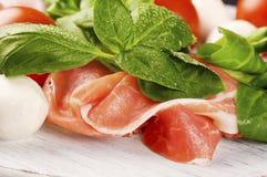 Prosciutto Smoked Pork Ham Rashers with tomato and mozzarella Royalty Free Stock Image