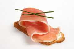 Prosciutto snack. On isolated background Royalty Free Stock Photos