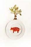 Prosciutto su un piatto e su un albero Fotografia Stock