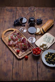 Prosciutto Wine Cheese And Olives Stock Image