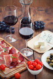 Prosciutto wine cheese and olives Stock Photo