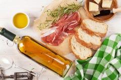 Prosciutto, wine, ciabatta, parmesan and olive oil Stock Image