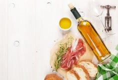Prosciutto, wine, ciabatta, parmesan and olive oil Royalty Free Stock Image