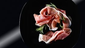 Prosciutto With Rosemary. Royalty Free Stock Image