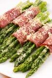 Prosciutto wrapped asparagus Stock Photo