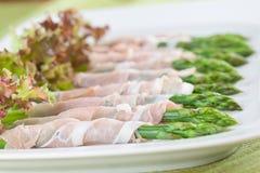 Prosciutto wrapped asparagus Stock Photos