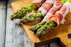 Prosciutto wrapped green asparagus Royalty Free Stock Image