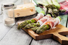 Prosciutto wrapped green asparagus Royalty Free Stock Images