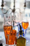 Prosecco and Aperol Spritz. Glasses of Prosecco and Aperol Spritzes on a restaurant table setting royalty free stock photography