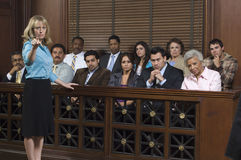 Prosecutor With Jury In Court
