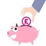 Prosiątko bank i biznesowy ręki kładzenia pieniądze, waluta Funtowy symbol dla ratować pojęcie wewnątrz Zdjęcie Royalty Free