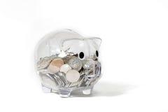Prosiątko bank odizolowywający na bielu z pieniądze fotografia stock