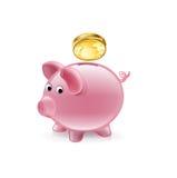 Prosiątko bank z złoty menniczy spadać  Zdjęcia Royalty Free
