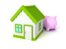 Prosiątko bank z zieleń dachu domem na bielu Obrazy Stock