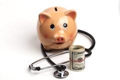 Prosiątko banka opieka zdrowotna obrazy royalty free