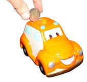 Prosiątko banka zabawki samochód Obrazy Royalty Free