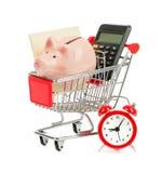 Prosiątka bank, papier i kalkulator w wózek na zakupy, Zdjęcia Royalty Free