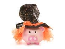 Prosiątko bank jest ubranym szalenie hatter kapelusz Obraz Royalty Free