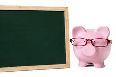 Prosiątko bank z pustym blackboard Zdjęcia Stock