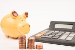 Prosiątko banka kalkulator Obrazy Stock