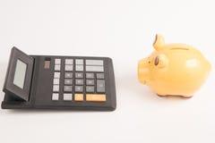 Prosiątko banka kalkulator Zdjęcia Royalty Free