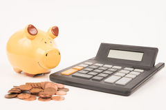 Prosiątko banka kalkulatora monety Zdjęcie Stock