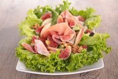 Prosicutto with fresh fig Stock Images