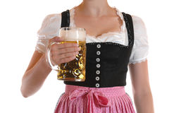 Prosit. Young woman with a beer mug, dressed in a Bavarian dirndl Royalty Free Stock Photos