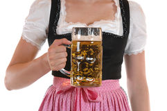Prosit. Young woman with a beer mug, dressed in a Bavarian dirndl Stock Image