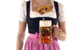 Prosit. Young woman with a beer mug, dressed in a Bavarian dirndl Stock Photography