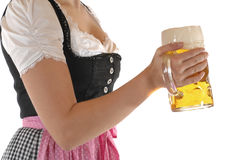 Prosit. Young woman with a beer mug, dressed in a Bavarian dirndl Stock Images