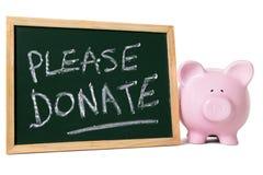 Prosiątko bank z dobroczynności wiadomością Zdjęcia Royalty Free