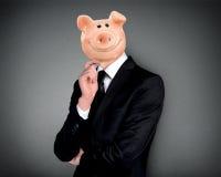 Prosiątko banka głowy biznesowy mężczyzna Zdjęcie Stock